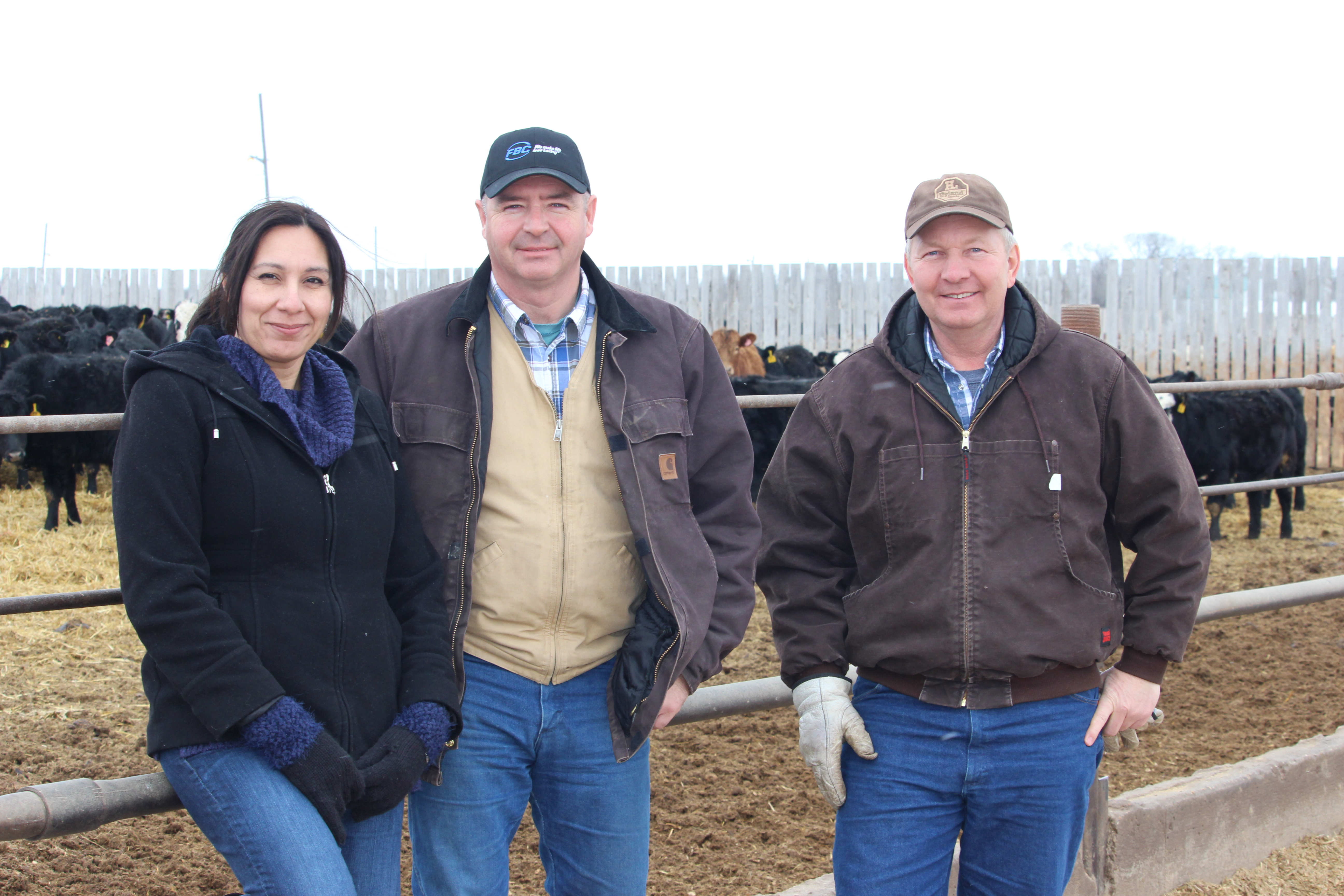 Dr. Claudia Narvaez(left) and mentor Tom Teichroeb (centre) tour Martin Unrau's (right) feedlot